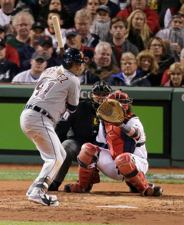 Description of . Detroit Tigers' Victor Martinez is hit by a pitch from Boston Red Sox's Clay Buchholz in the fourth inning during Game 2 of the American League baseball championship series Sunday, Oct. 13, 2013, in Boston. (AP Photo/Charlie Riedel)