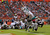 Ryan Tannehill #17 of the Miami Dolphins dives for a touchdown during a game against the New England Patriots at Sun Life Stadium on December 2, 2012 in Miami Gardens, Florida.  (Photo by Mike Ehrmann/Getty Images)