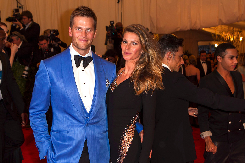 Description of . Model Gisele Bundchen arrives with quarterback Tom Brady at the Metropolitan Museum of Art Costume Institute Benefit celebrating the opening of