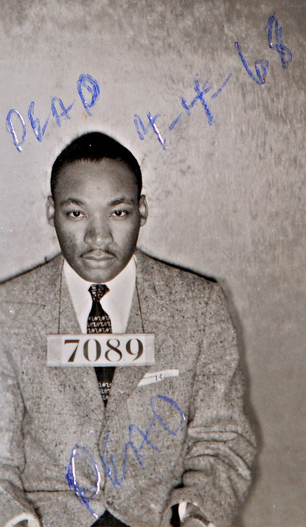 . A Montgomery (Ala.) Sheriff\'s Department booking photo of The Rev. Martin Luther King Jr. taken Feb 22, 1956, with the words \'\'Dead and the date of 4-4-68\'\' scrolled on it, is shown Friday, July 23, 2004, in Montgomery, Ala. Dozens of photographs from the civil rights-era were recently discovered in a storage room used by the Montgomery County Sheriff\'s office. Chief Deputy Derrick Cunningham said he was performing some house cleaning duties when he found a photo-album containing well-preserved mug shots of protesters who were arrested during the Montgomery bus boycott in 1956. (AP Photo/Montgomery County (Ala.) Sheriff\'s office)