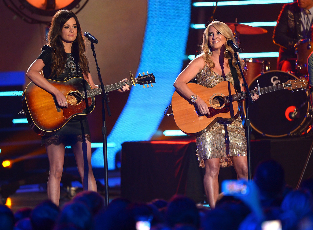 Description of . Kacey Musgraves and Lee Ann Womack perform onstage at the 2014 CMT Music Awards at Bridgestone Arena on June 4, 2014 in Nashville, Tennessee.  (Photo by Michael Loccisano/Getty Images for CMT)