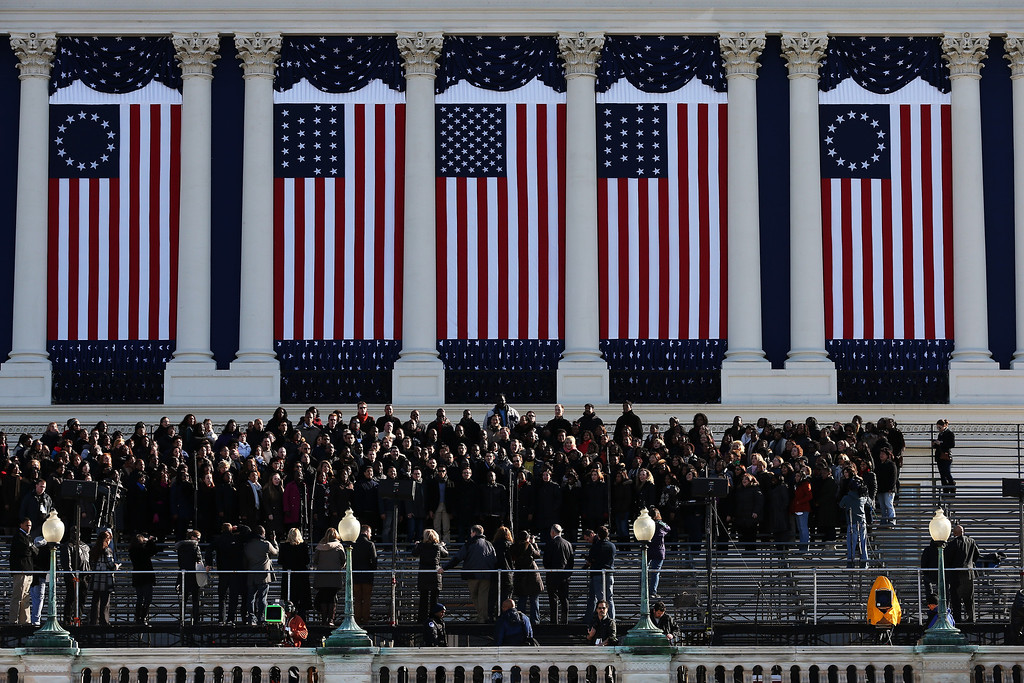 Description of . A group practices on a riser at the U.S. Capitol building as Washington prepares for U.S. President Barack Obama's second inauguration on January 20, 2013 in Washington, DC. Both Obama and U.S. Vice President Joe Biden will be officially sworn in today with a public ceremony for the President taking place on January 21.  (Photo by Justin Sullivan/Getty Images)