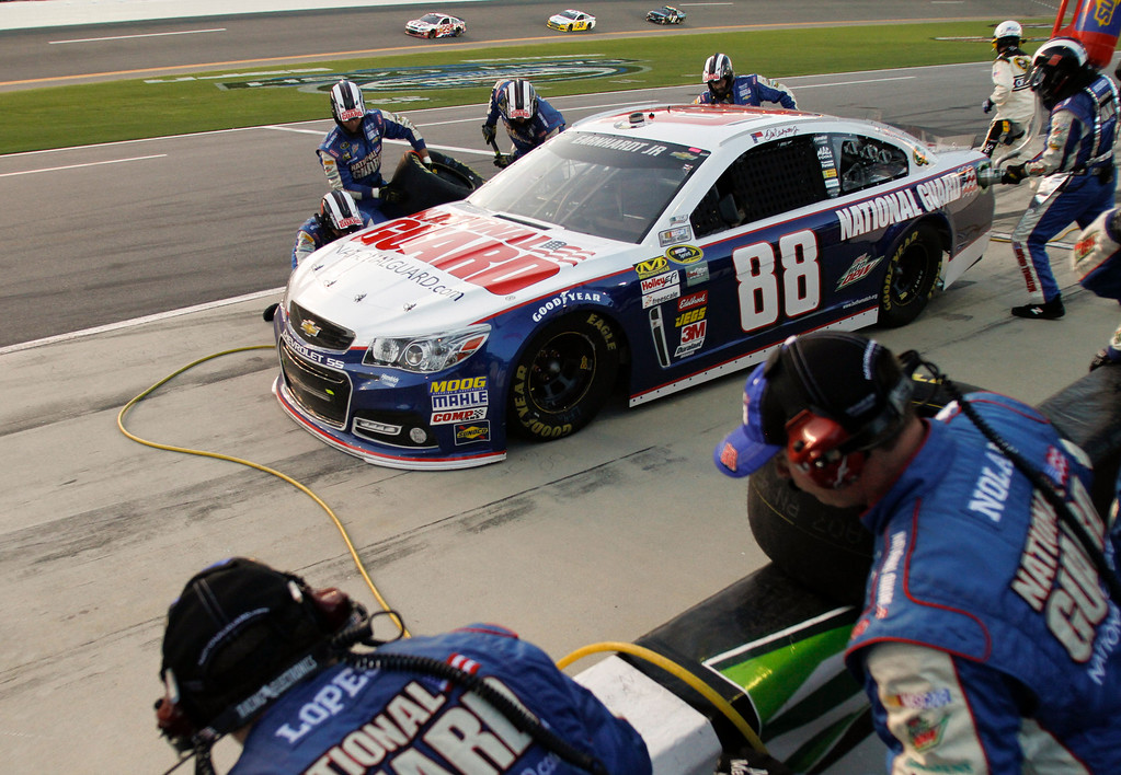 Description of . Dale Earnhardt Jr. makes a pit stop for fuel and tires during the NASCAR Sprint Cup auto race at Daytona International Speedway, Saturday, July 6, 2013, in Daytona Beach, Fla. (AP Photo/Reinhold Matay)