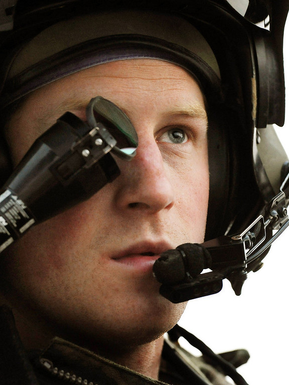 Description of . In this image released on January 21, 2013, Prince Harry, wears his monocle gun sight as he sits in the front seat of his cockpit at the British controlled flight-line at Camp Bastion on December 12, 2012 in Afghanistan. Prince Harry has served as an Apache Helicopter Pilot/Gunner with 662 Sqd Army Air Corps, from September 2012 for four months until January 2013.  (Photo by John Stillwell - WPA Pool/Getty Images)