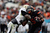 Josh Stewart #5 of the Oklahoma State Cowboys is tackled by Josh Johnson #28 of the Purdue Boilermakers during the Heart of Dallas Bowl at Cotton Bowl on January 1, 2013 in Dallas, Texas.  (Photo by Ronald Martinez/Getty Images)
