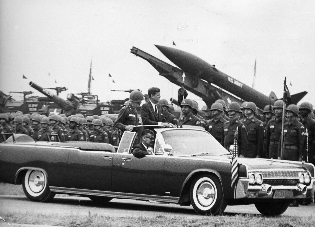 . Kennedy reviews troops and weaponry while riding in a stretch limousine during an inspection at Hanau in Germany.  Keystone/Getty Images