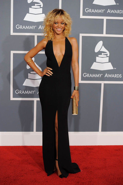 Description of . Rihanna arrives at the 54th annual Grammy Awards on Sunday, Feb. 12, 2012 in Los Angeles. (AP Photo/Chris Pizzello)