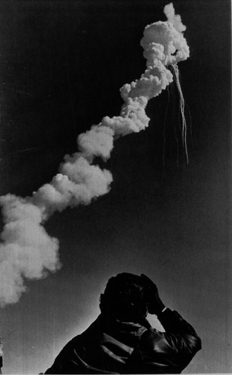 Description of . A Lockheed employe at the Kennedy Space Center watches as the space shuttle Challenger explodes in the air. A crew of seven died in the tragedy including teacher astronaut Christa McAuliffe.  Denver Post Library Archive