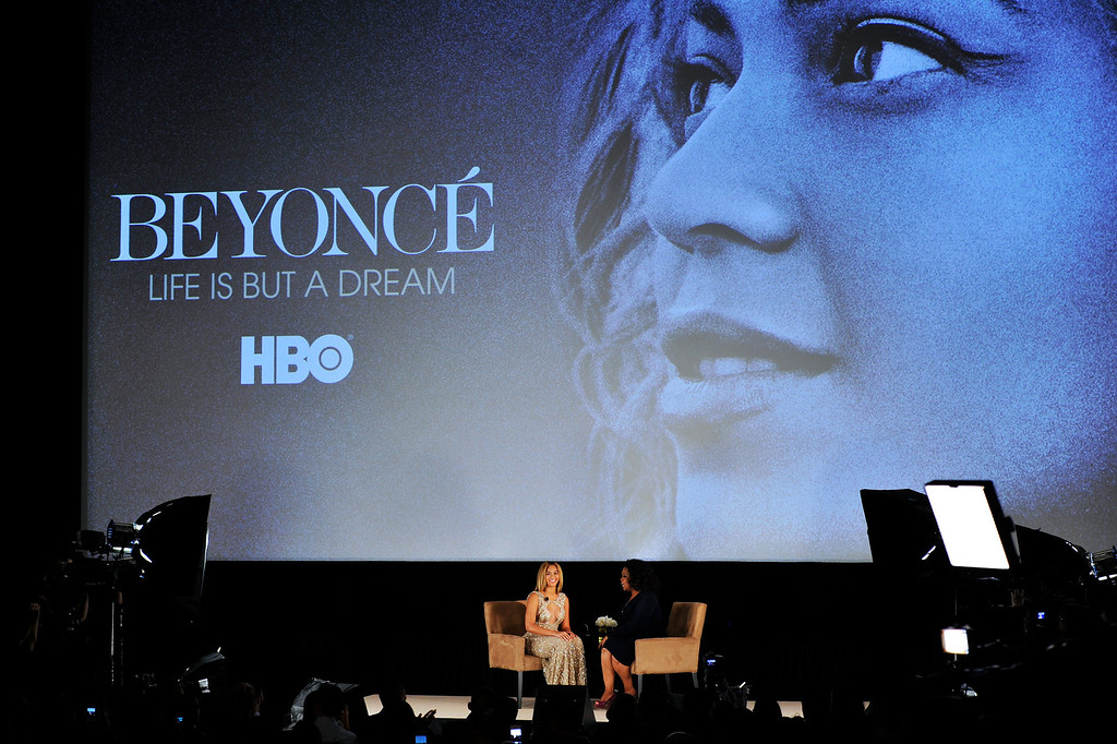 Description of . NEW YORK, NY - FEBRUARY 12:  Beyonce and Oprah Winfrey speak onstage at the HBO Documentary Film