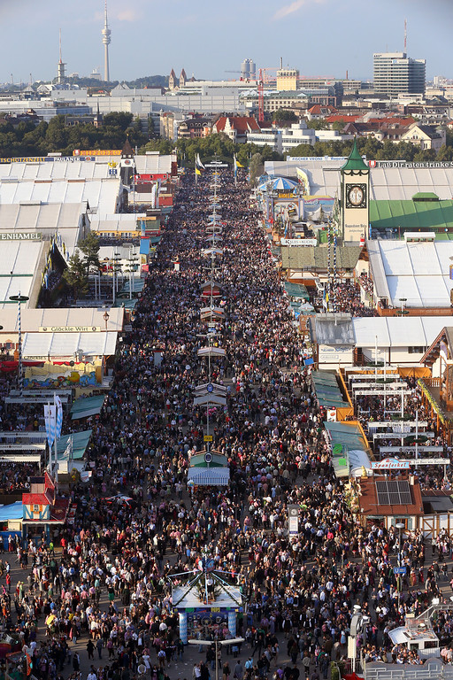 Description of . General view during day 1 of the Oktoberfest 2013 beer festival at Theresienwiese on September 21, 2013 in Munich, Germany. The Munich Oktoberfest, which this year will run from September 21 through October 6, is the world's largest beer fest and draws millions of visitors.  (Photo by Alexander Hassenstein/Getty Images)