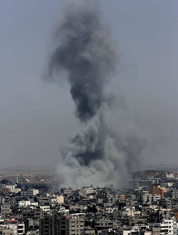 Description of . Smoke from Israeli strikes rise over Gaza City, in the northern Gaza Strip, in the northern Gaza Strip, Wednesday, July 30, 2014. On Wednesday, Israeli aircraft struck dozens of Gaza sites, including five mosques it said were being used by militants, while several other areas came under tank fire.(AP Photo/Adel Hana)