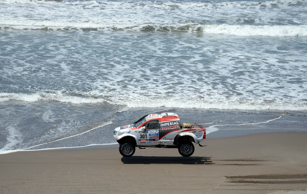 Description of . Toyota's driver Giniel De Villiers of South Africa competes during Stage 4 of the Dakar 2013 between Nazca and Arequipa, Peru, on January 8, 2013. The rally will take place in Peru, Argentina and Chile from January 5 to 20. FRANCK FIFE/AFP/Getty Images