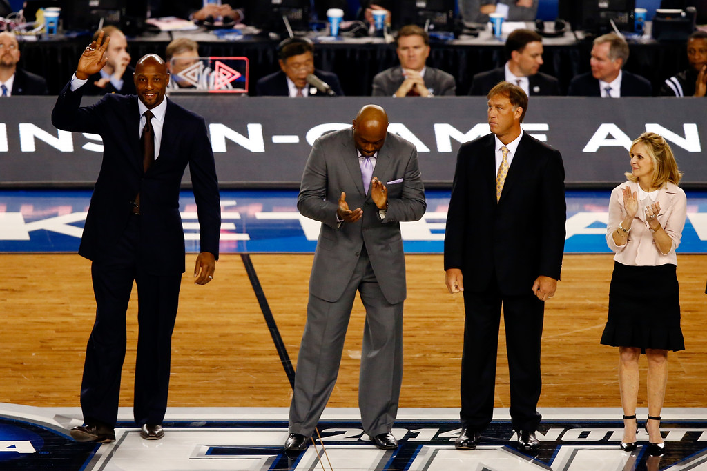 Description of . ARLINGTON, TX - APRIL 07:  Naismith Memorial Basketball Hall of Fame inductee Alonzo Mourning acknowledges the crowd during the NCAA Men\'s Final Four Championship between the Kentucky Wildcats and the Connecticut Huskies at AT&T Stadium on April 7, 2014 in Arlington, Texas.  (Photo by Tom Pennington/Getty Images)