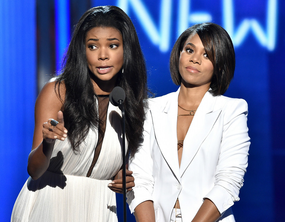 Description of . Actresses Gabrielle Union (L) and Regina Hall speak onstage during the BET AWARDS '14 at Nokia Theatre L.A. LIVE on June 29, 2014 in Los Angeles, California.  (Photo by Kevin Winter/Getty Images for BET)