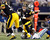 Pittsburgh Steelers quarterback Ben Roethlisberger (2nd L) is sacked by Dallas Cowboys linebacker Anthony Spencer (back) and linebacker DeMarcus Ware (on ground), as center Maurkice Pouncey (L) blocks in the second half of their NFL football game in Arlington, Texas December 16, 2012.  REUTERS/Mike Stone