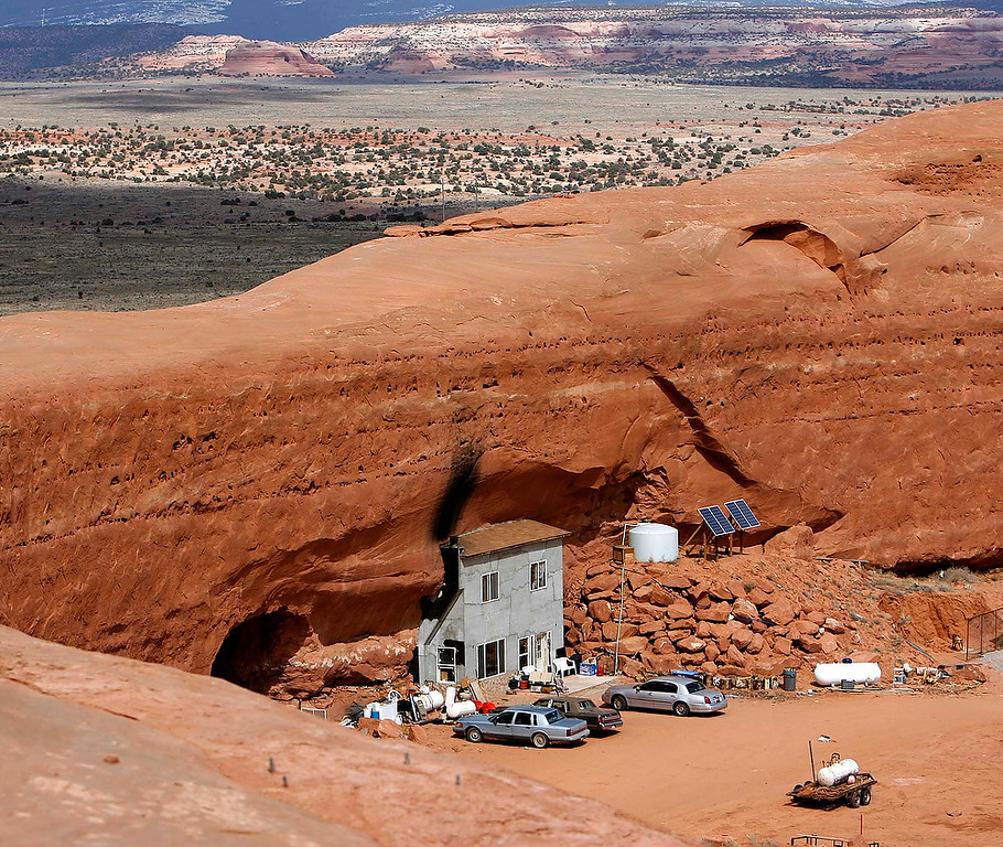 Description of . A house built within a sandstone slab is seen in this March 18, 2006 photo, south of Moab, Utah. Thirty years after he figured the end was near and moved to what he thought was a safer place, Bob Foster and a fundamentalist Mormon community continue to live in an astonishing creation he calls Rockland Ranch. (AP Photo/The Salt Lake Tribune, Trent Nelson)