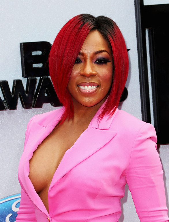 Description of . Recording artist K.Michelle attends the 2013 BET Awards at Nokia Theatre L.A. Live on June 30, 2013 in Los Angeles, California.  (Photo by Frederick M. Brown/Getty Images for BET)
