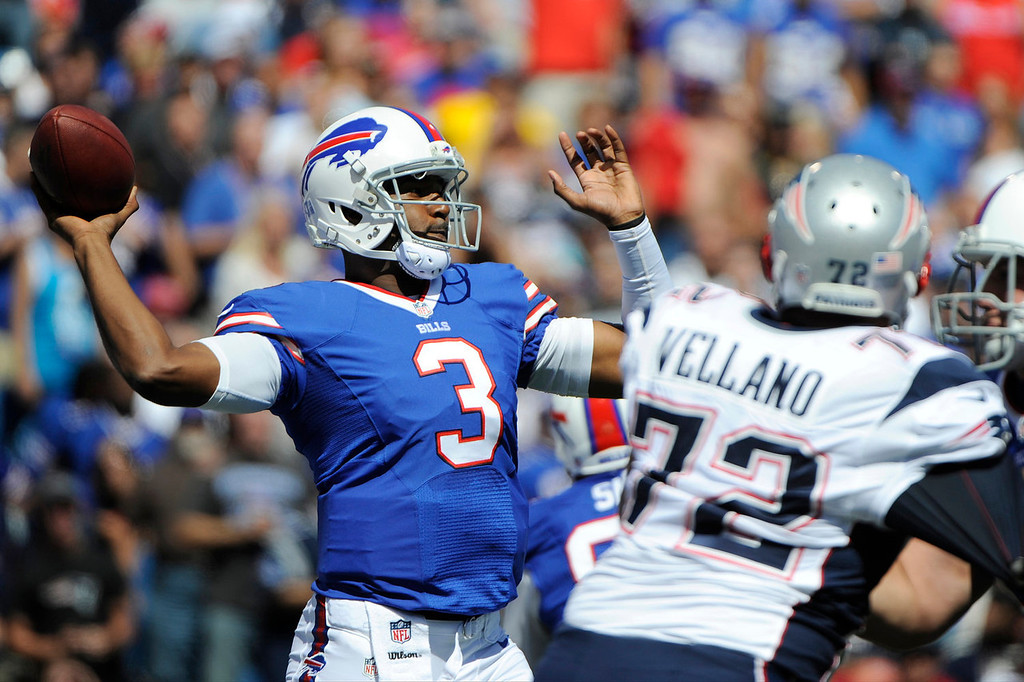 Description of . Buffalo Bills quarterback EJ Manuel (3) throws a pass during the first half of an NFL football game as New England Patriots defensive tackle Joe Vellano (72) rushes the passer on Sunday, Sept. 8, 2013, in Orchard Park. (AP Photo/Gary Wiepert)
