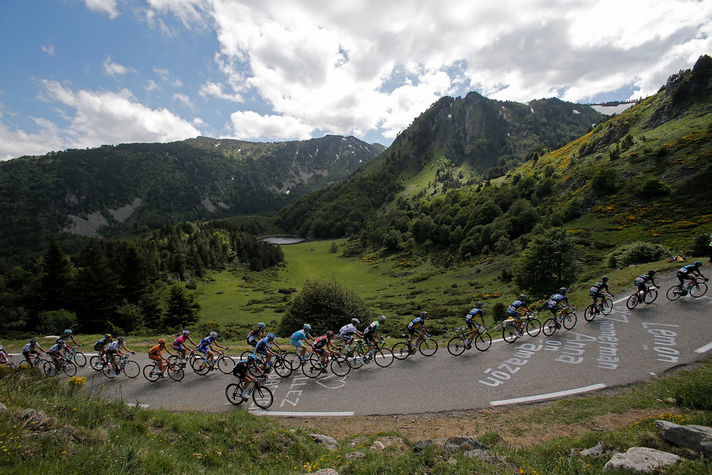Description of . The pack climbs Pailheres pass during the eight stage of the Tour de France cycling race over 195 kilometers (122 miles) with start in Castres and finish in Ax 3 Domaines, Pyrenees region, France, Saturday July 6 2013. (AP Photo/Christophe Ena)