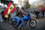 Supporters of Venezuela's President Hugo Chavez ride on motobikes through the city as a reaction to the announcement of his death in Caracas, March 5, 2013. Chavez has died after a two-year battle with cancer, ending the socialist leader's 14-year rule of the South American country, Vice President Nicolas Maduro said in a televised speech on Tuesday.    REUTERS/Jorge Silva