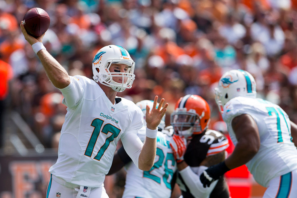 Description of . Quarterback Ryan Tannehill #17 of the Miami Dolphins looks for a pass during the first half against the Cleveland Browns at First Energy Stadium on September 8, 2013 in Cleveland, Ohio. (Photo by Jason Miller/Getty Images)