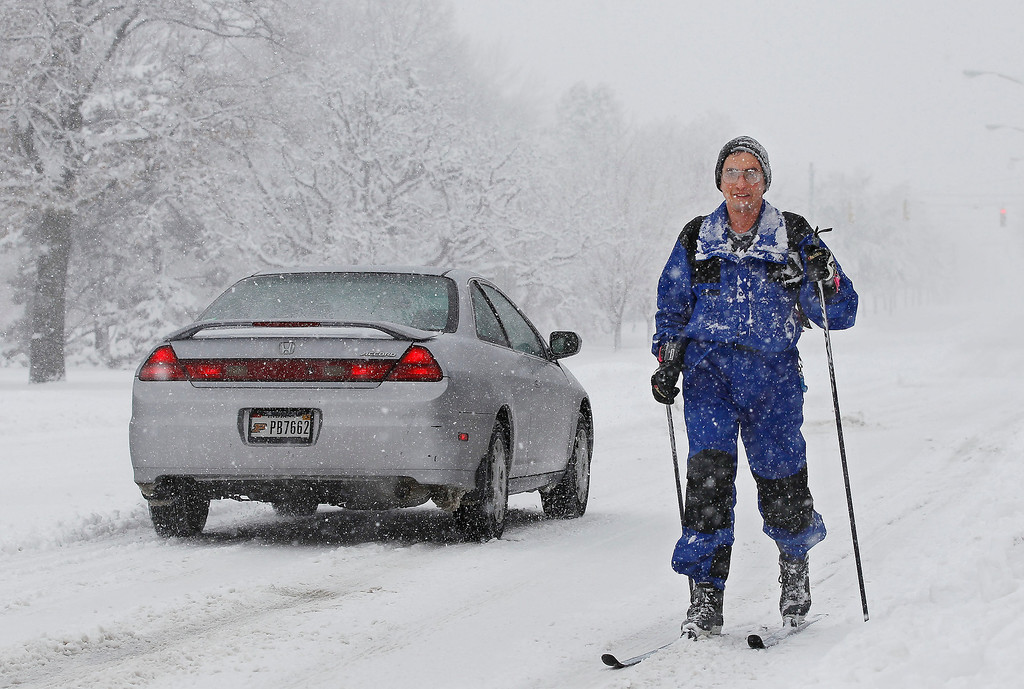 Description of . Dave Dull cross country skis along State Street to his office Sunday, Jan. 5, 2014, on the campus of Purdue University in West Lafayette, Ind. Dull said he wanted to get out for a little fresh air and some exercise. The National Weather Service issued a winter storm warning until late Sunday for central Indiana (AP Photo/Journal & Courier, John Terhune)