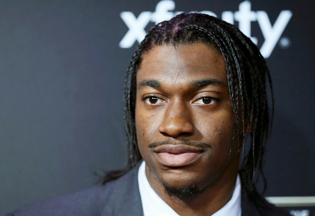 Description of . Washington Redskins quarterback Robert Griffin III arrives at the 2nd Annual NFL Honors in New Orleans, Louisiana, February 2, 2013. The San Francisco 49ers will meet the Baltimore Ravens in the NFL Super Bowl XLVII football game February 3.  REUTERS/Lucy Nicholson
