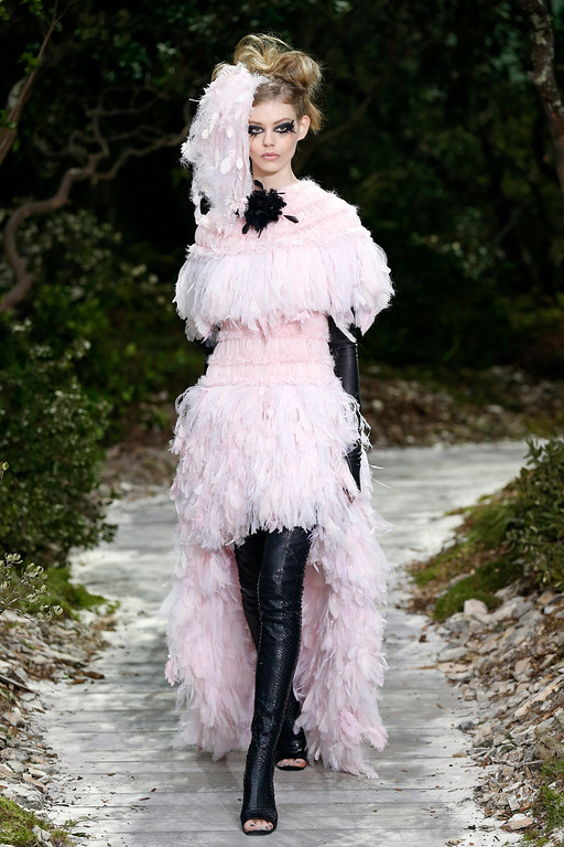 Description of . A model presents a creation by German designer Karl Lagerfeld for French fashion house Chanel as part of his Haute Couture Spring-Summer 2013 fashion show in Paris January 22, 2013. REUTERS/Benoit Tessier