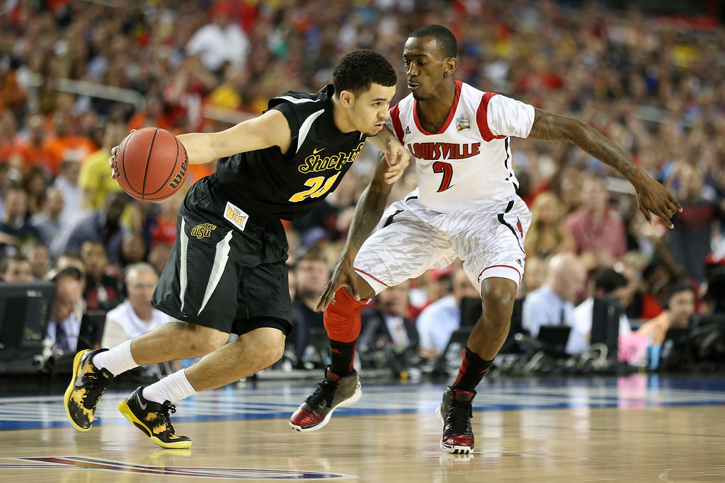 Description of . ATLANTA, GA - APRIL 06:  Fred VanVleet #23 of the Wichita State Shockers drives the ball in the first half against Russ Smith #2 of the Louisville Cardinals during the 2013 NCAA Men's Final Four Semifinal at the Georgia Dome on April 6, 2013 in Atlanta, Georgia.  (Photo by Andy Lyons/Getty Images)