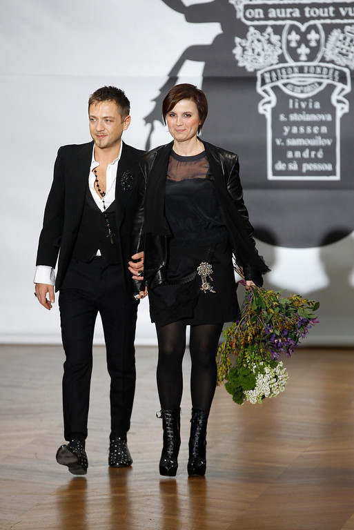 Description of . Bulgarian designers Livia Stoianova, right, and Yassen Samouilov appear after the presentation of their collection for On Aura Tour Vu's Spring Summer 2013 Haute Couture fashion collection, in Paris, Wednesday, Jan.23, 2013. (AP Photo/Remy de la Mauviniere)