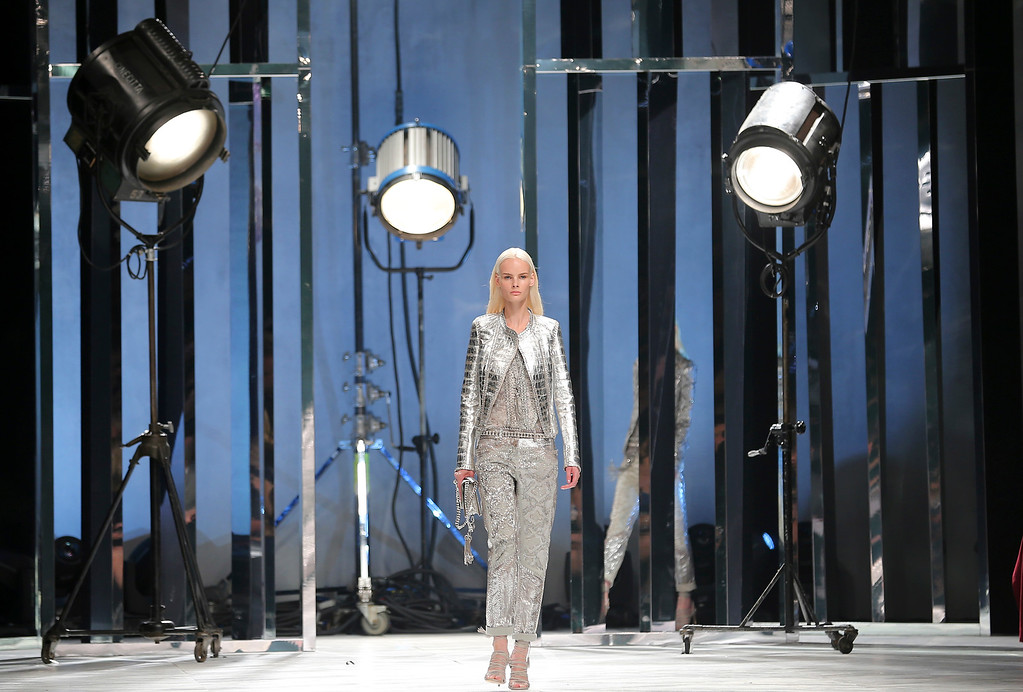 Description of . A model wears a creation for Roberto Cavalli women's Spring-Summer 2014 collection, part of the Milan Fashion Week, unveiled in Milan, Italy, Saturday, Sept. 21, 2013. (AP Photo/Antonio Calanni)