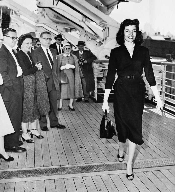 Description of . Shapely Rita Hayworth, who never looked better, walks on the promenade deck of the Queen Elizabeth, much to the delight of her fellow passengers, as the liner docked. The actress is returning to the U.S. to make her first movie in three years. To be released by Columbia, it will be called Fire Down Below. (Copyright Bettmann/Corbis / AP Images)