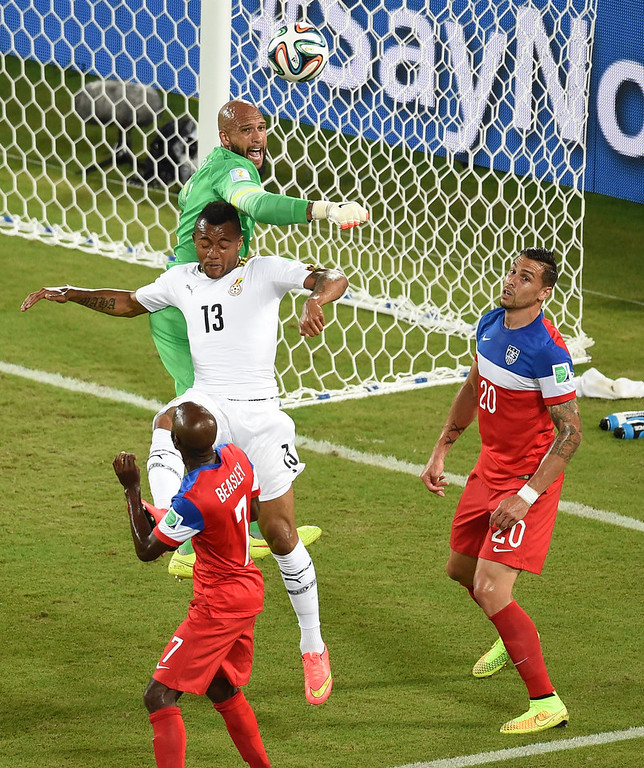 Description of . US goalkeeper Tim Howard (L) jumps for the ball behind Ghana's forward Jordan Ayew (C) during a Group G football match between Ghana and US at the Dunas Arena in Natal during the 2014 FIFA World Cup on June 16, 2014.  JAVIER SORIANO/AFP/Getty Images