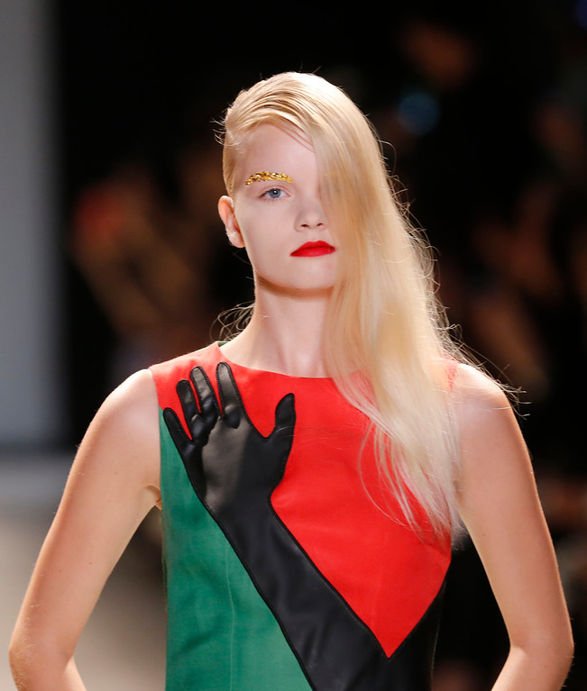 Description of . A model wears a creation for Jean-Charles de Castelbajac's ready-to-wear Spring/Summer 2014 fashion collection, presented in Paris, Tuesday, Oct.1, 2013. (AP Photo/Jacques Brinon)