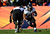 Baltimore Ravens running back Ray Rice (27) runs the ball for a small gain in the first quarter. The Denver Broncos vs Baltimore Ravens AFC Divisional playoff game at Sports Authority Field Saturday January 12, 2013. (Photo by AAron  Ontiveroz,/The Denver Post)