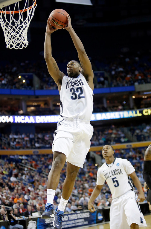 Description of . Villanova's James Bell (32) dunks the ball as teammate Tony Chennault (5) trails the play during first half of a second-round game against Milwaukee in the NCAA college basketball tournament in Buffalo, N.Y., Thursday, March 20, 2014. (AP Photo/Nick LoVerde)