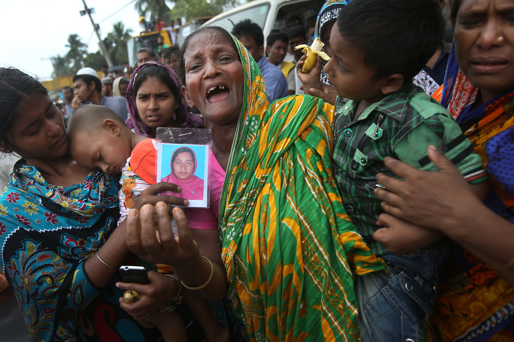 Description of . A woman grieves for her daughter-in-law who was trapped in the collapsed garment factory building on Tuesday 30, April, 2013 in Savar, near Dhaka, Bangladesh.  (AP Photo/Wong Maye-E)