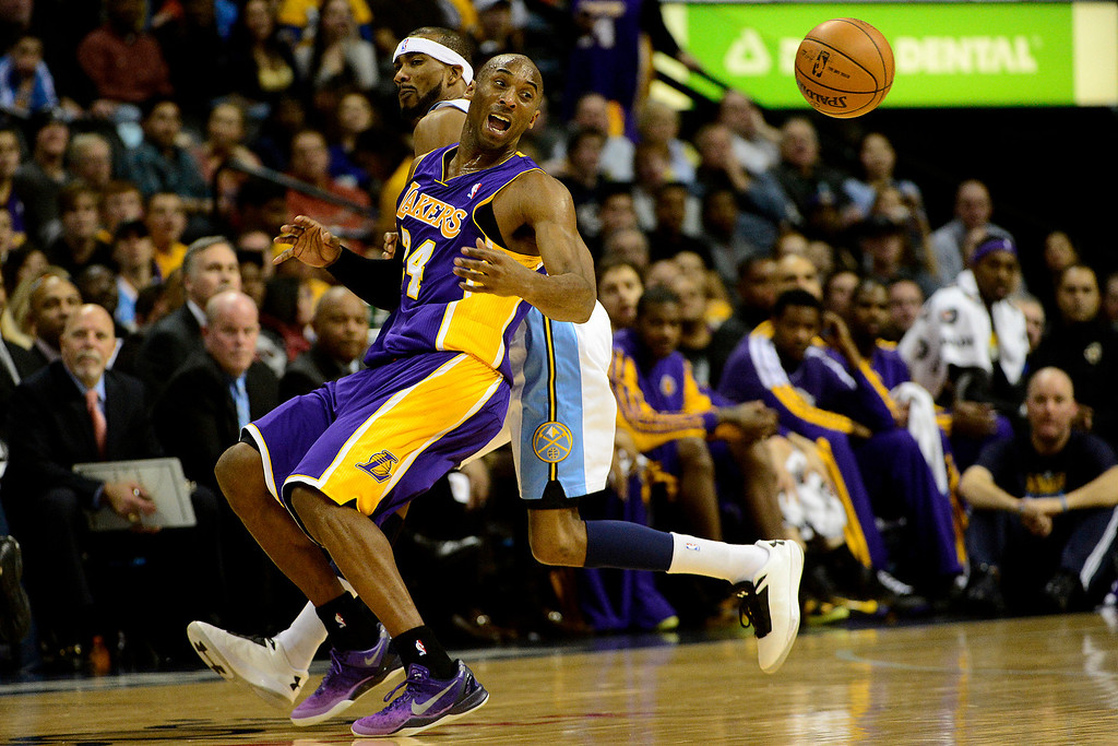 Description of . Los Angeles Lakers shooting guard Kobe Bryant (24) loses the ball after Denver Nuggets small forward Corey Brewer (13) poked it away during the first half at the Pepsi Center on Wednesday, December 26, 2012. AAron Ontiveroz, The Denver Post