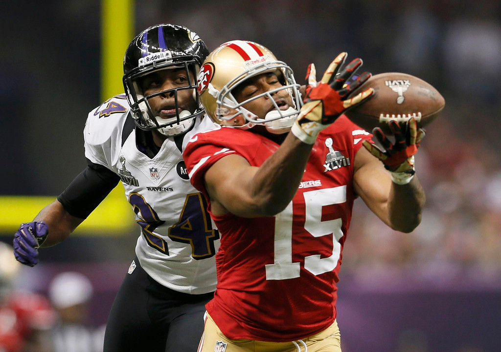 Description of . San Francisco 49ers wide receiver Michael Crabtree (15) is unable to hang onto a pass against Baltimore Ravens cornerback Corey Graham (24) in the third quarter in the NFL Super Bowl XLVII football game in New Orleans, Louisiana, February 3, 2013. REUTERS/Lucy Nicholson