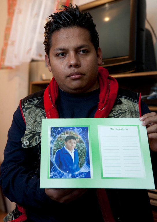 Description of . Enrique Martinez shows a photograph of his brother Samuel, who according to authorities was killed by feral dogs on Saturday, during an interview at his home in Iztapalapa, Mexico City. Tuesday, Jan. 8, 2013. The fatal mauling of four people by feral dogs in a Mexico City park set off debate Tuesday about the city's love/hate relationship with its dog population, and the guilt or innocence of 25 animals trapped near the scene of the nightmarish killings. (AP Photo/Eduardo Verdugo)