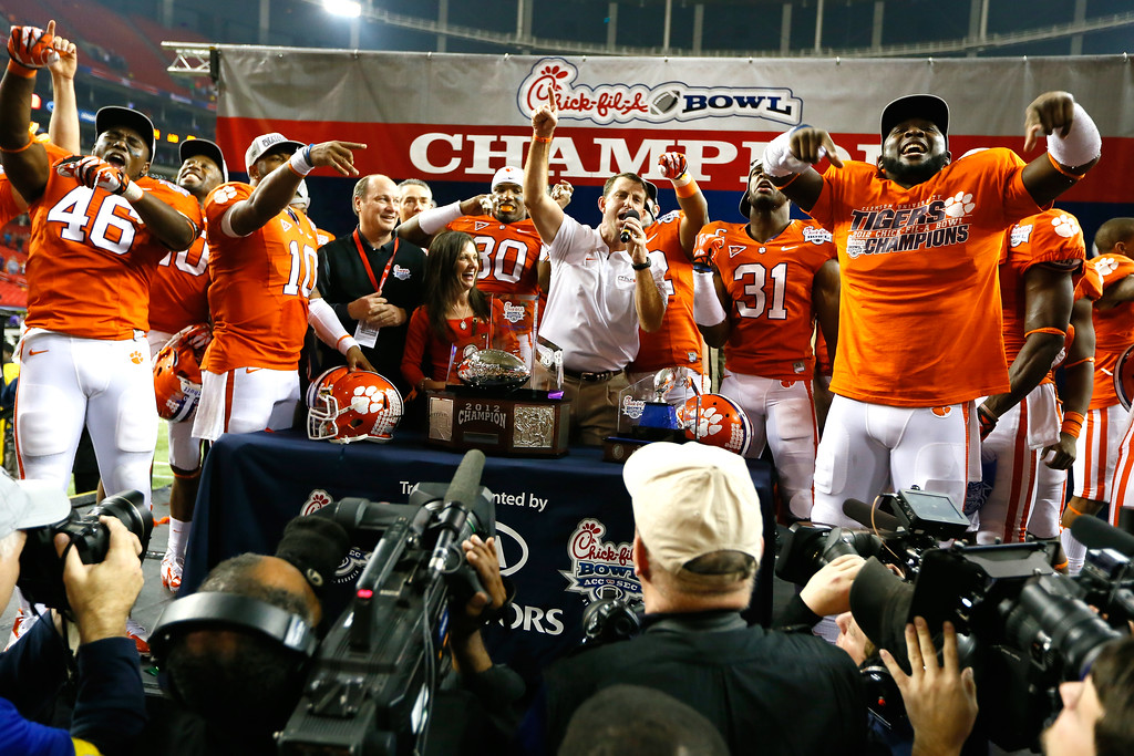 Description of . ATLANTA, GA - JANUARY 01:  Head coach Dabo Swinney and his Clemson Tigers celebrate their 25-24 win over the LSU Tigers during the 2012 Chick-fil-A Bowl at Georgia Dome on December 31, 2012 in Atlanta, Georgia.  (Photo by Kevin C. Cox/Getty Images)