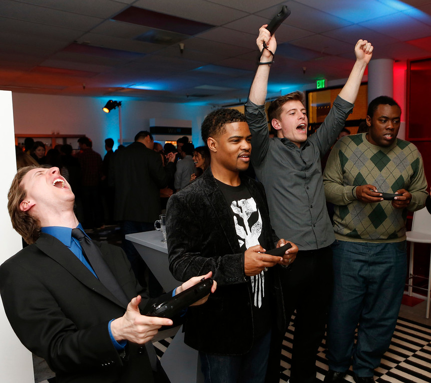 Description of . Jared Knabenbauer (from Pro Jared), Damon Scott (from Broken Pixels), TJ Smith (from Ivy League Punk) and Andre Meadows (from Black Nerd Comedy) play the Wii U at the Nintendo Wii U Video Challenge at the Nintendo Lounge at Sundance 2013, on Thursday, Jan.,17, 2013 in Park City, Utah. (Photo by Todd Williamson/Invision for Nintendo/AP Images)