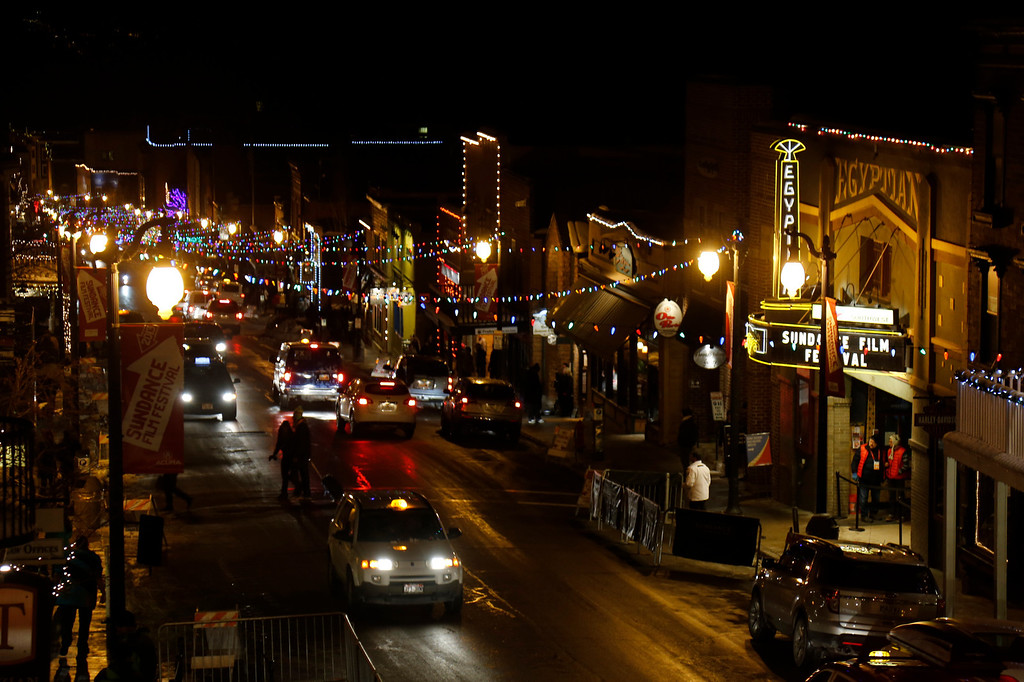 Description of . Cars drive past the marquee at the Egyptian Theatre on Main Street at night during the 2013 Sundance Film Festival on Thursday, Jan. 17, 2013 in Park City, Utah. (Photo by Danny Moloshok/Invision/AP)