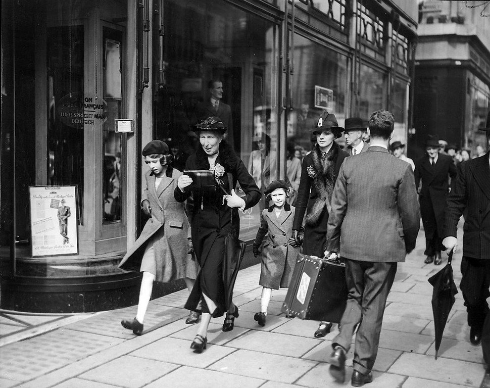 Description of . Unrecognized by passers-by, Britain\'s Princess Elizabeth, left, and her sister Princess Margaret, are taken for a walk through busy London streets on May 15, 1939, after their first ride on a London Underground train. They were accompanied by their governess and a lady-in-waiting. (AP-Photo)