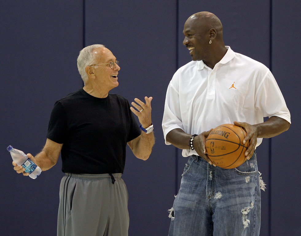Description of . Charlotte Bobcats coach Larry Brown, left, talks with part-owner Michael Jordan, right, after pre-draft workouts for the team in Charlotte, N.C., Wednesday, June 25, 2008. (AP Photo/Chuck Burton)