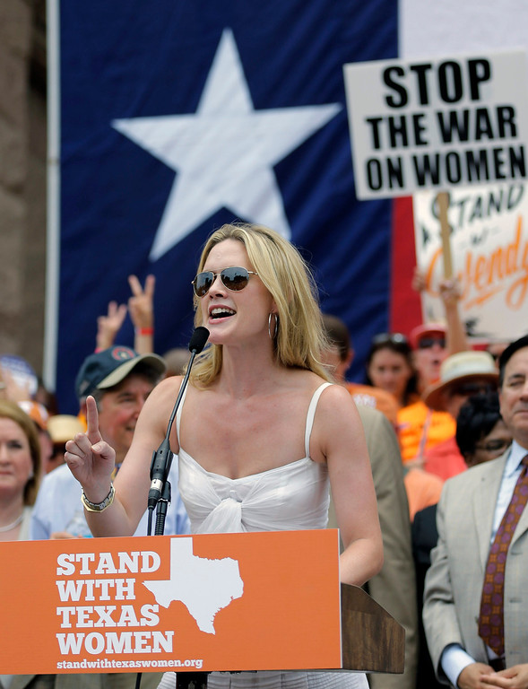 Description of . Actress Alexandra Cabot speaks during a rally supporting abortion rights outside the Texas Capitol, Monday, July 1, 2013, in Austin, Texas. The Texas Senate has convened for a new 30-day special session to take up a contentious abortion restrictions bill and other issues. (AP Photo/Eric Gay)