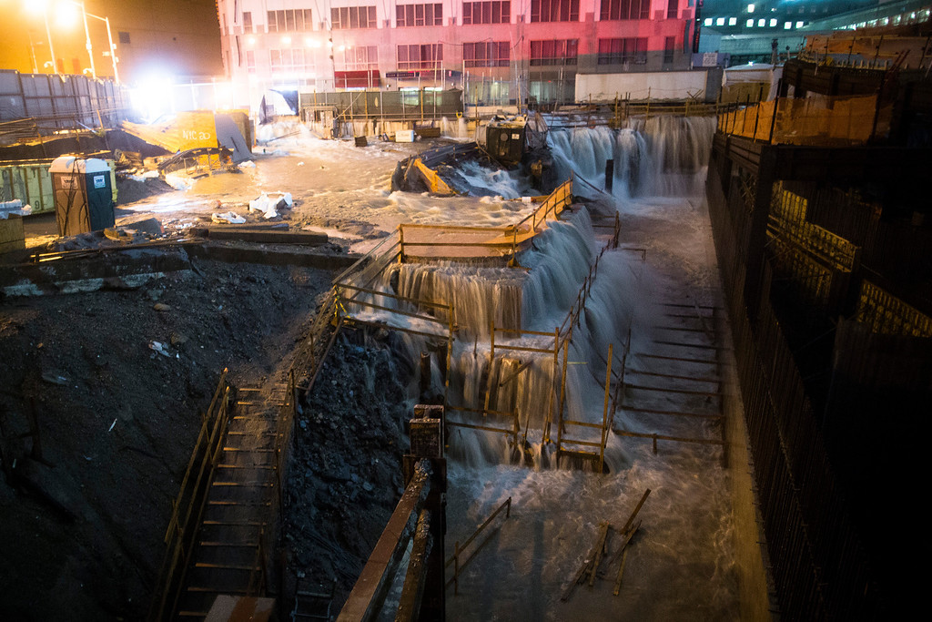 Description of . In this Oct. 29, 2012 file photo, sea water floods the World Trade Center construction site in New York during Superstorm Sandy.  (AP Photo/John Minchillo, File)