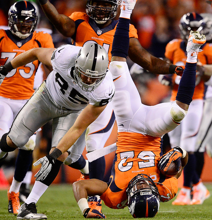 . Denver Broncos outside linebacker Wesley Woodyard (52) falls over after recovering a fumbled that was called back in the second quarter. The Denver Broncos took on the Oakland Raiders at Sports Authority Field at Mile High in Denver on September 23, 2013. (Photo by AAron Ontiveroz/The Denver Post)