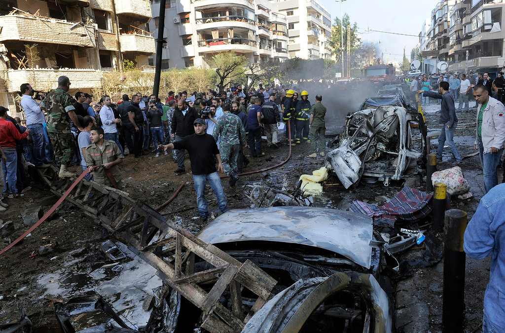 Description of . A general view of the scene after a number of explosions near the Iranian embassy in Beirut, Lebanon, 19 November 2013. Reports vary regarding fatalities but at least 15 people are believed to have been killed in south Beirut a stronghold of the Hezbollah militant movement.  EPA/WAEL HAMZEH