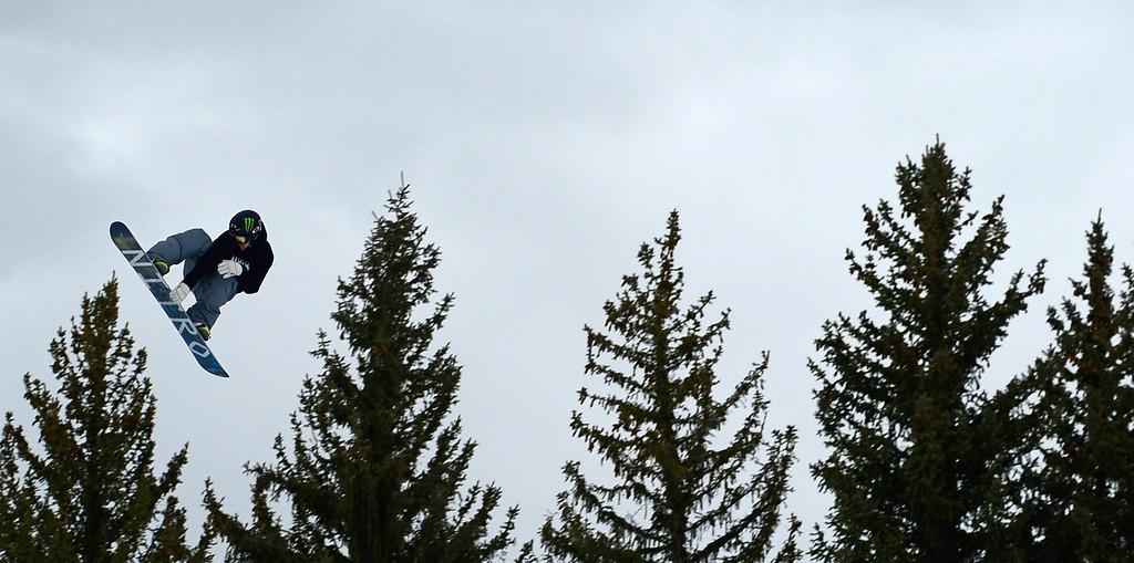 Description of . ASPEN, CO. - JANUARY 24: Gjermund Braaten rides above the trees during the men's Snowboard Slopestyle elimination. Men's Snowboard Slopestyle elimination X Games Aspen Buttermilk Mountain Aspen January 24, 2013. (Photo By AAron Ontiveroz / The Denver Post)